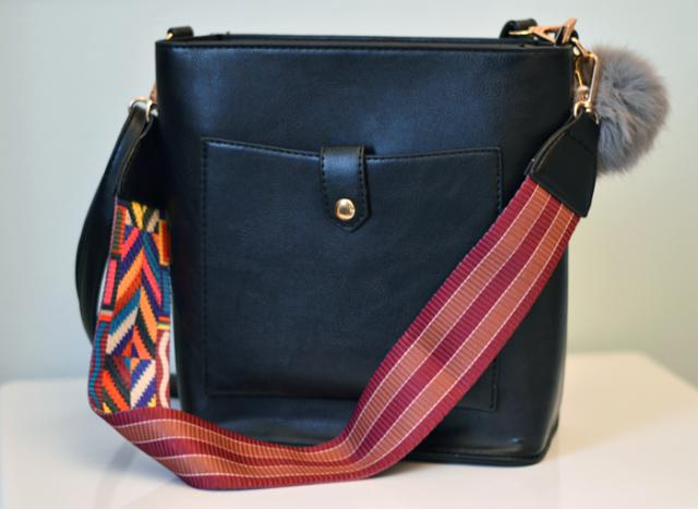 Love this bag!  The pompom is so soft and you can choose between 2 straps :)