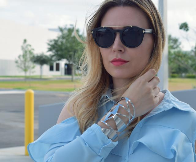 Love the dress and the corset together with the beautiful sunnies and bracelet. Check out more on www.leilad.com