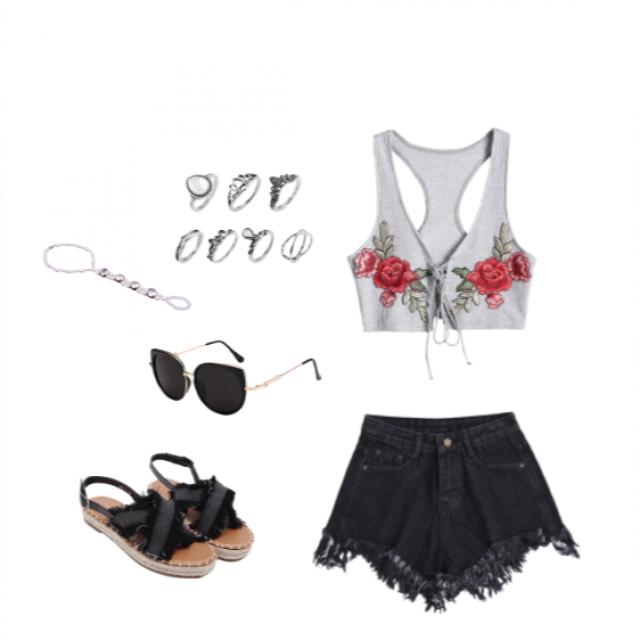 A chill and super trendy outfit. The embroidery gives it a delicate touch but therufle shorts and the sandals give it …