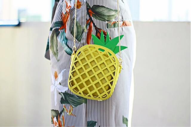 This pineapple shaped crossbody bag is so fun it hurts not to get one. It's a perfect accessory for this season and it's